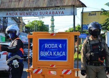 Ilustrasi yustisi protokol kesehatan di pintu masuk perbatasan Kota Surabaya dan Kabupaten Sidoarjo /Ist